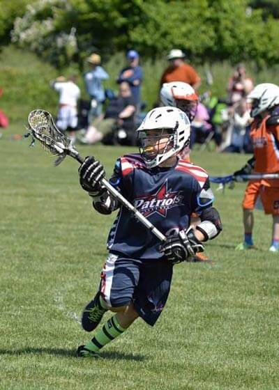 Kid playing LaCrosse